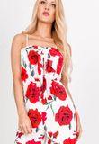 Dlhý biely overal s červenými kvetmi