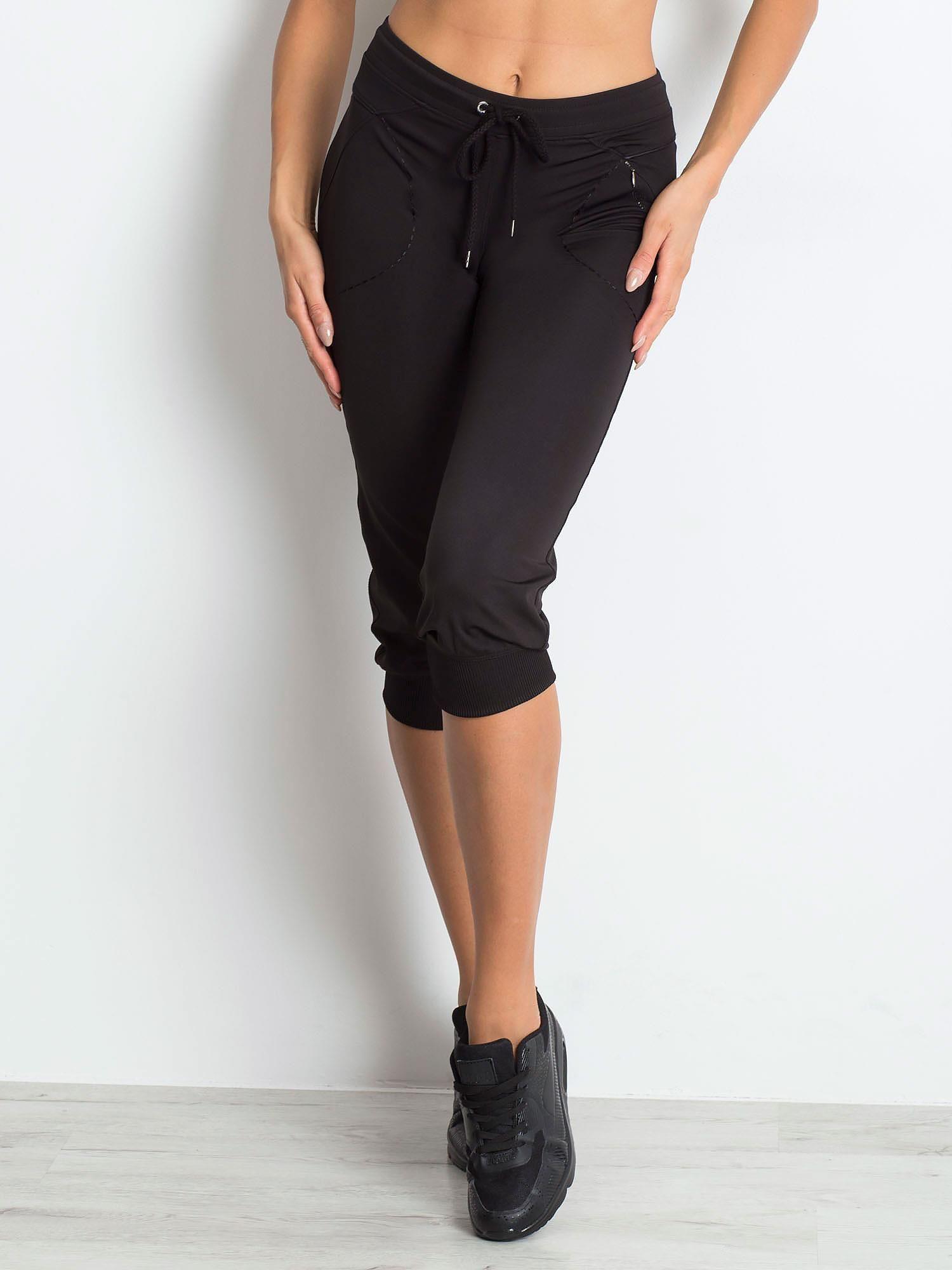 Čierne capri nohavice s vreckami - XS