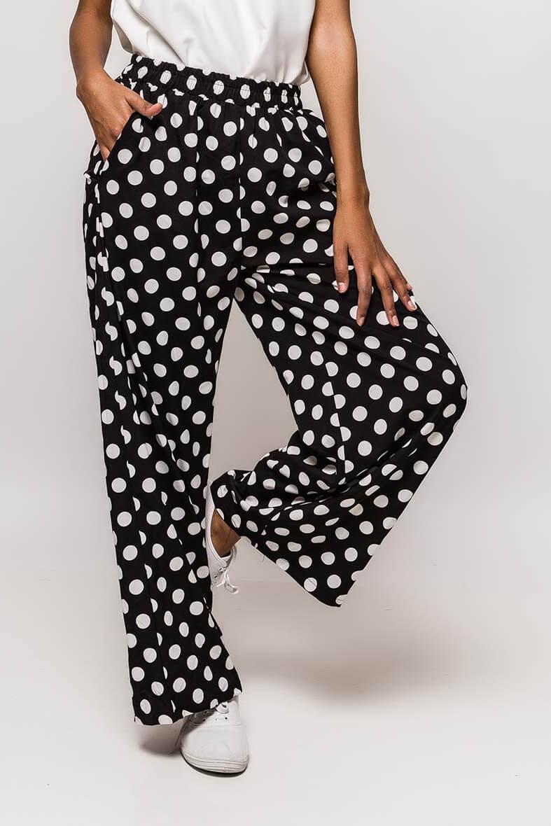 Čierne bodkované dámske nohavice - S/M