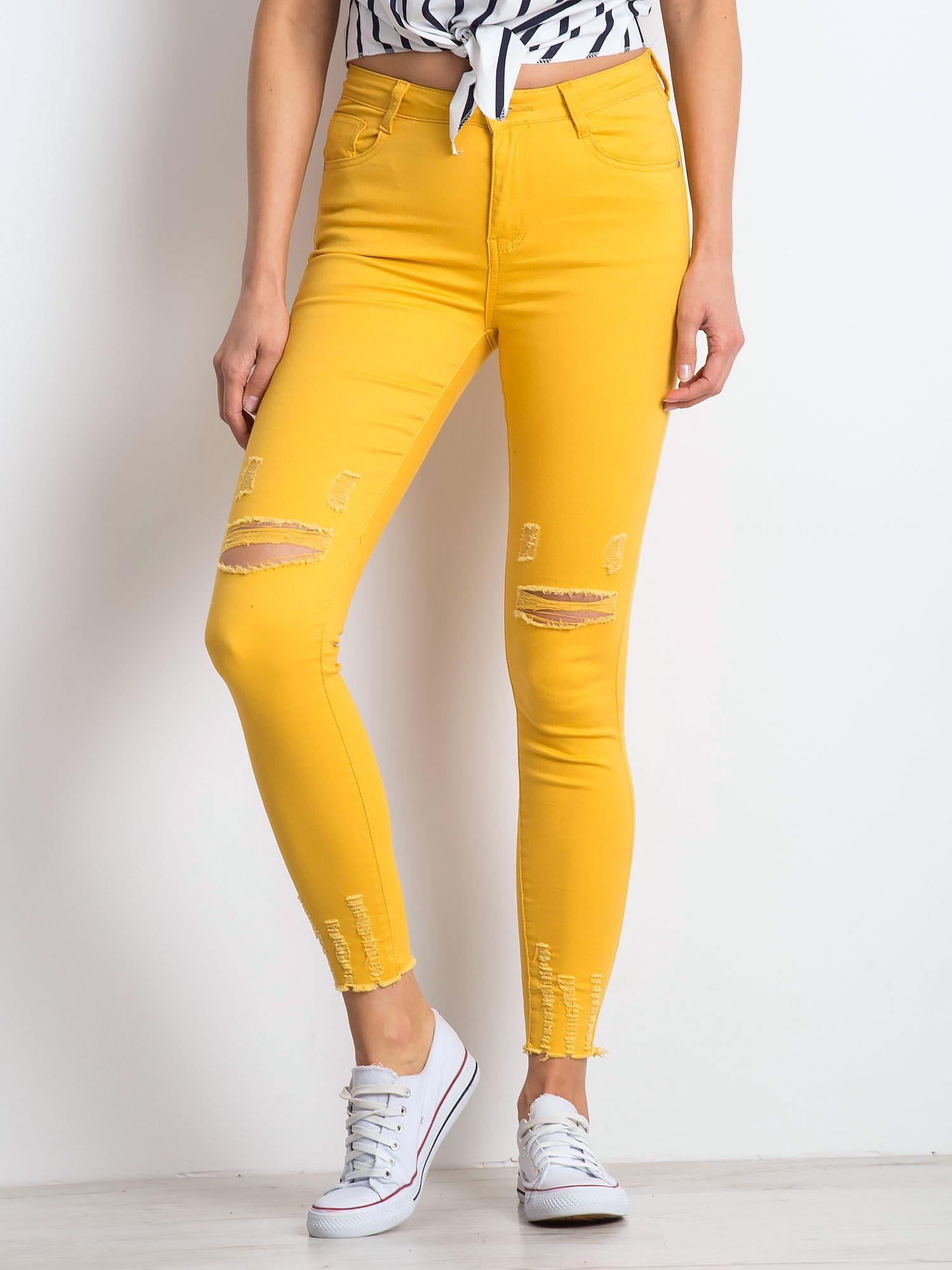 Žlté 7/8 roztrhané nohavice - 34