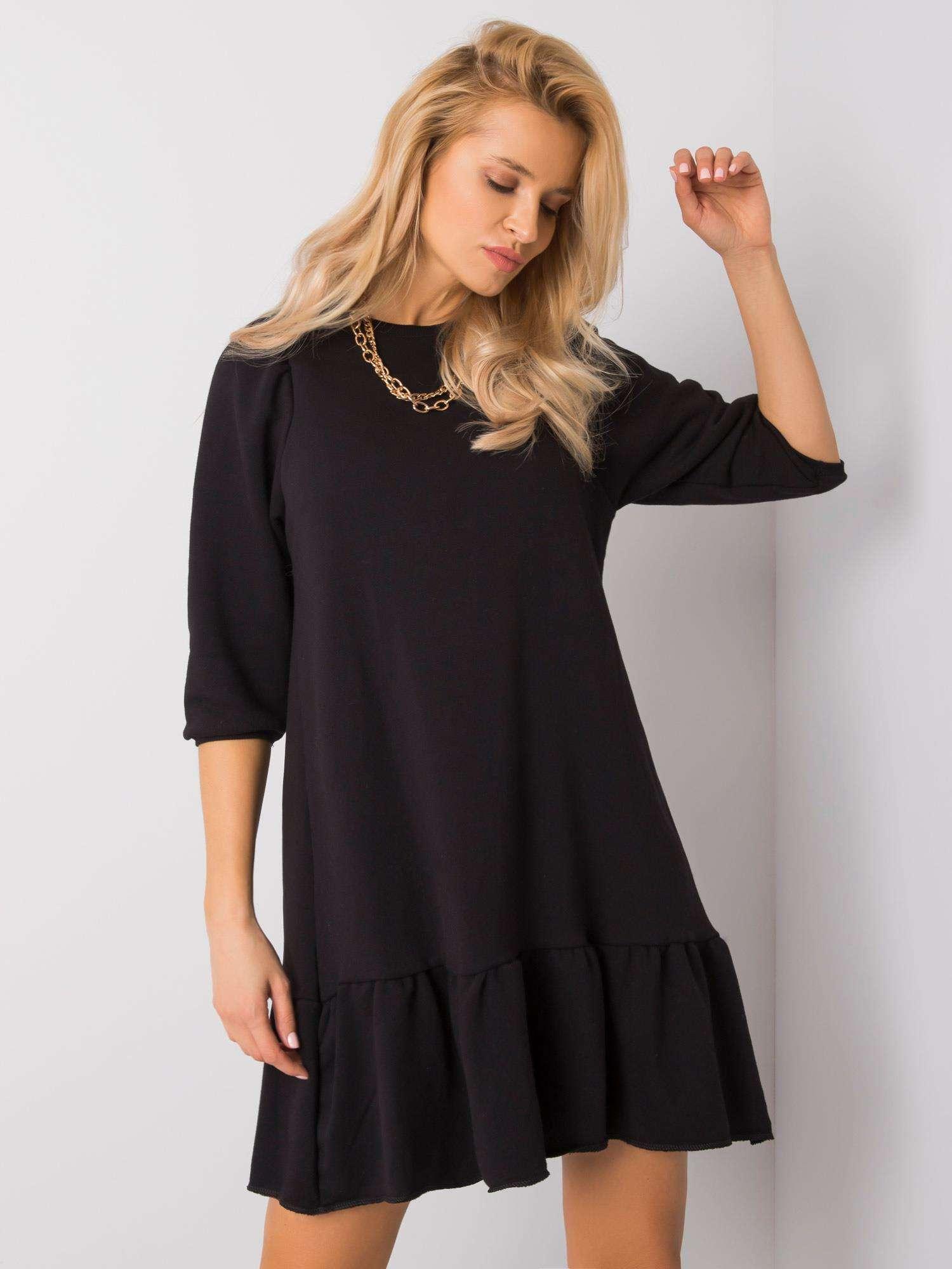 Dámske čierne šaty s volánom - L